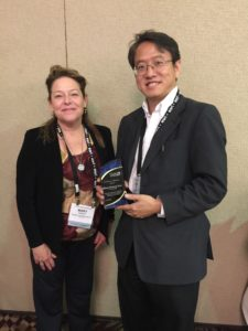 Ming-Hsiang Tsou (right) accepted award for Excellence in Education with Mary Hurley (Chair, left)